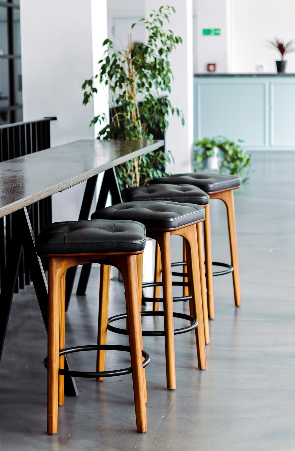 black leather padded brown wooden chairs