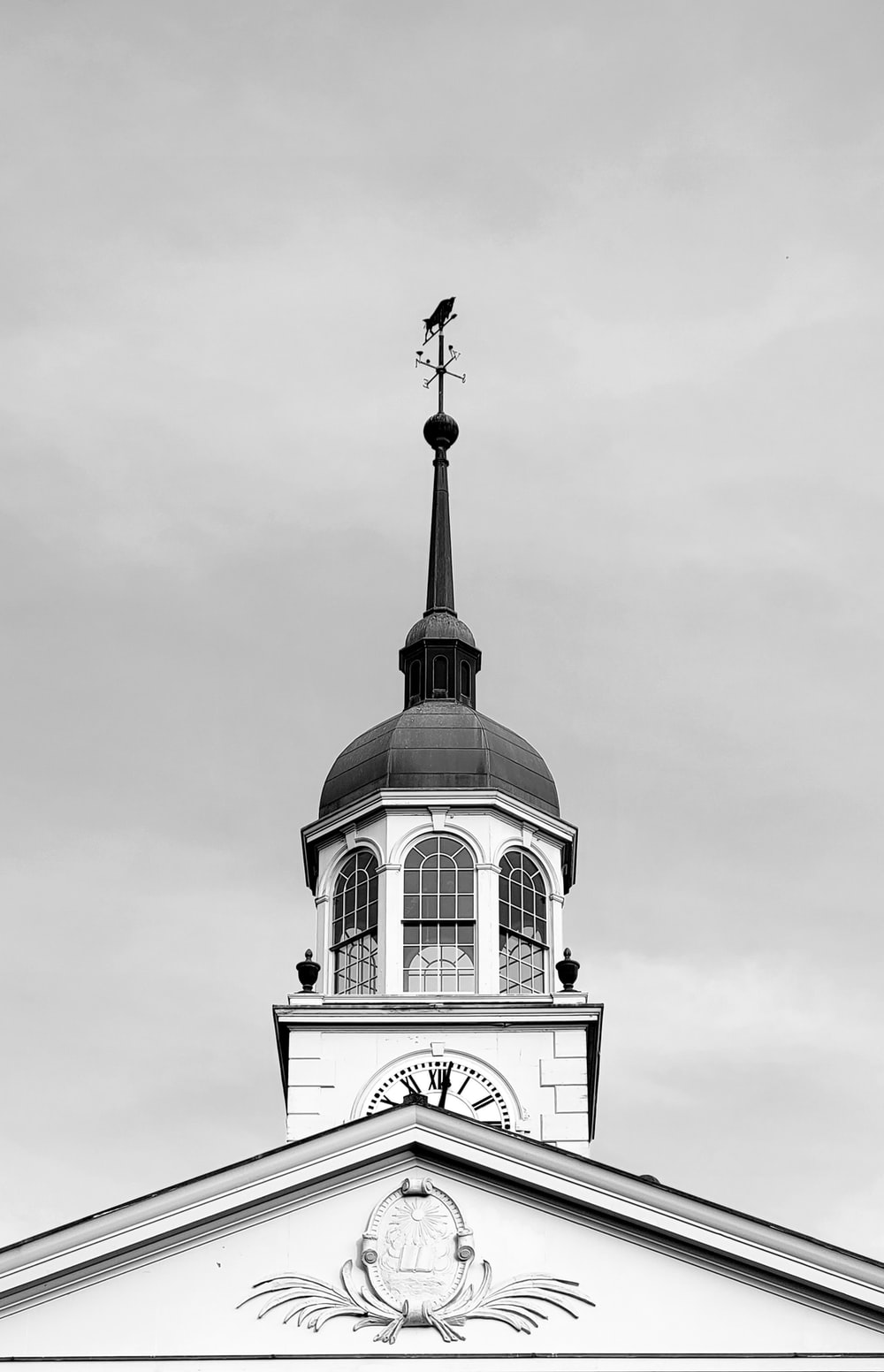 grayscale photo of clock tower