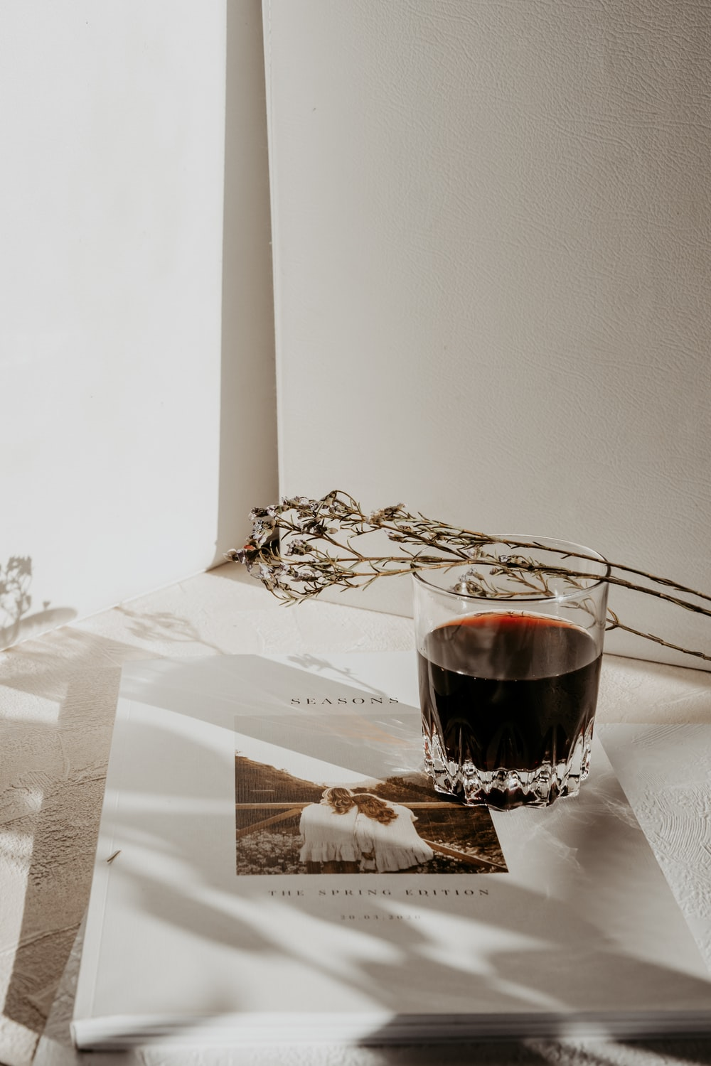 clear wine glass on white paper