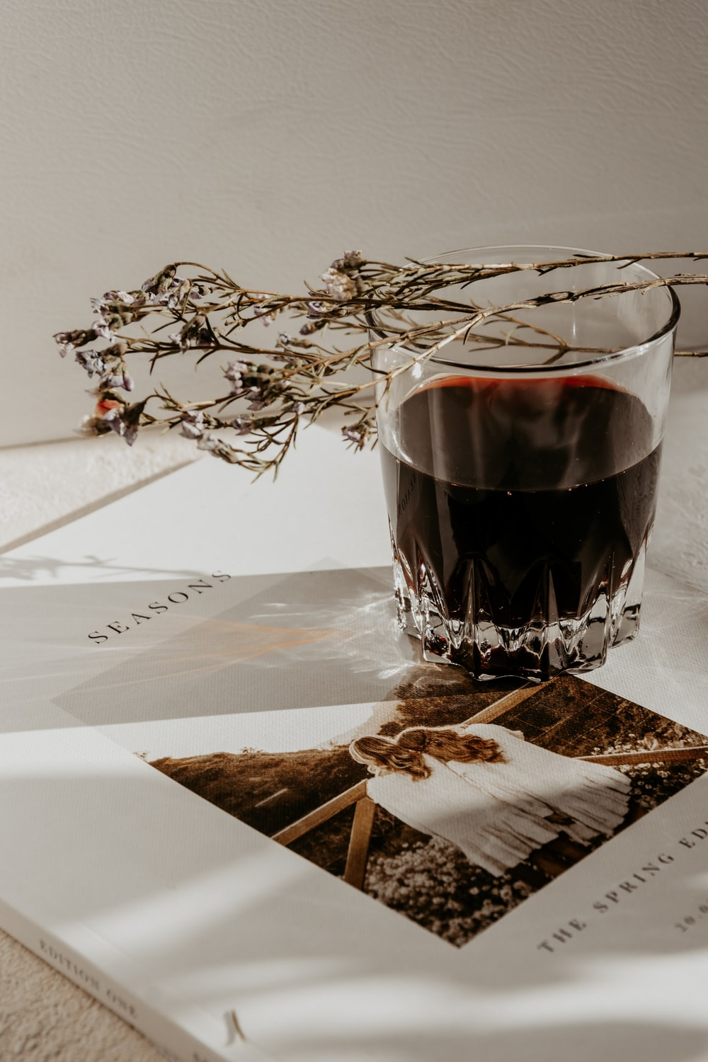 clear drinking glass with red wine