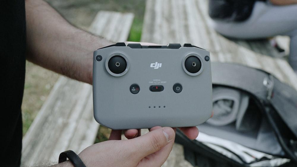 person holding gray nintendo game controller