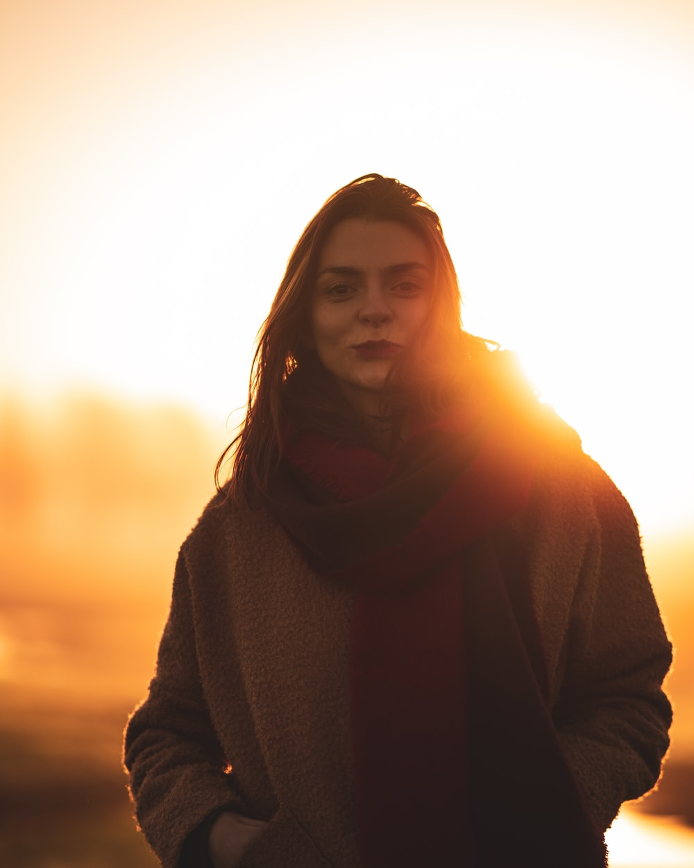 woman in black sweater standing during sunset