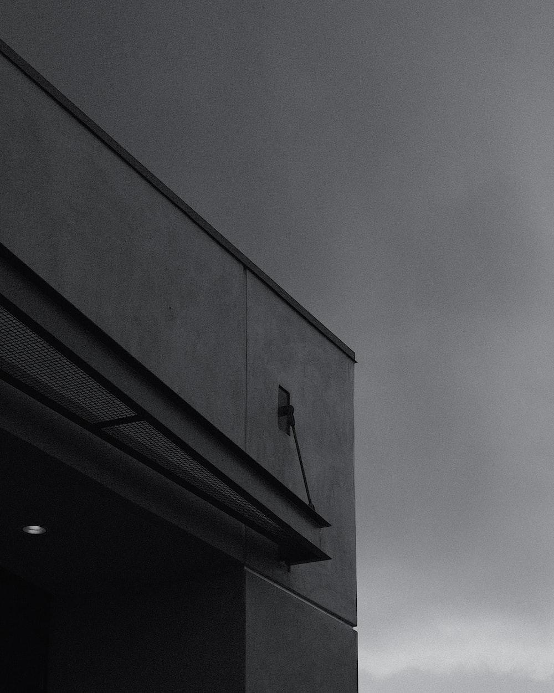 black concrete building under gray sky