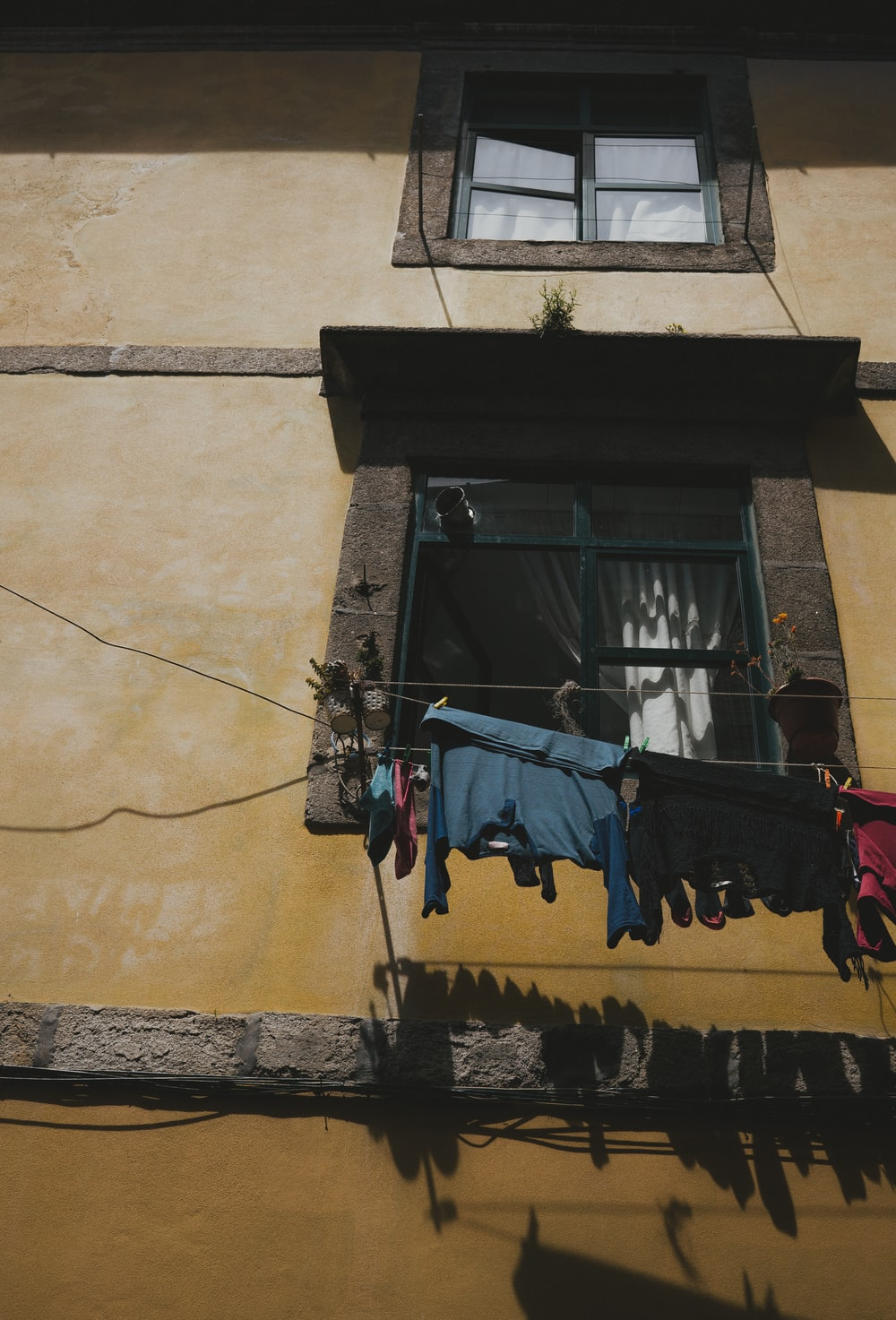clothes hanged on string near window