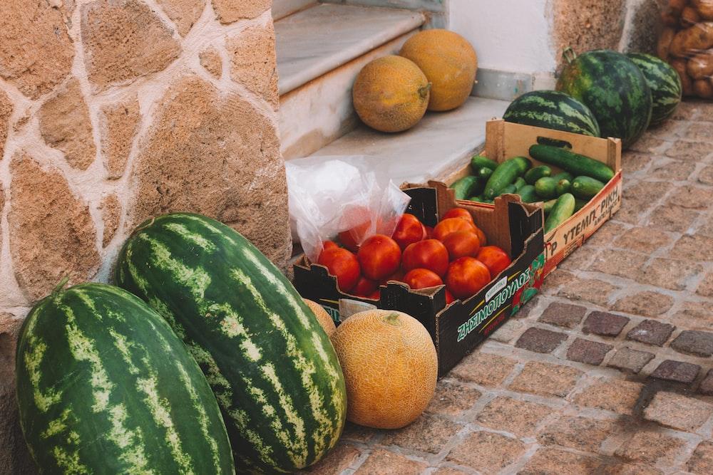 green watermelon and orange fruits