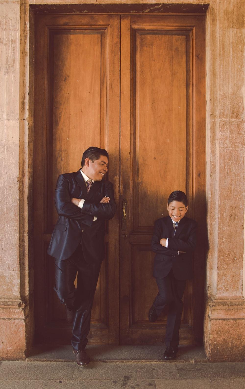 man in black suit standing beside man in black suit