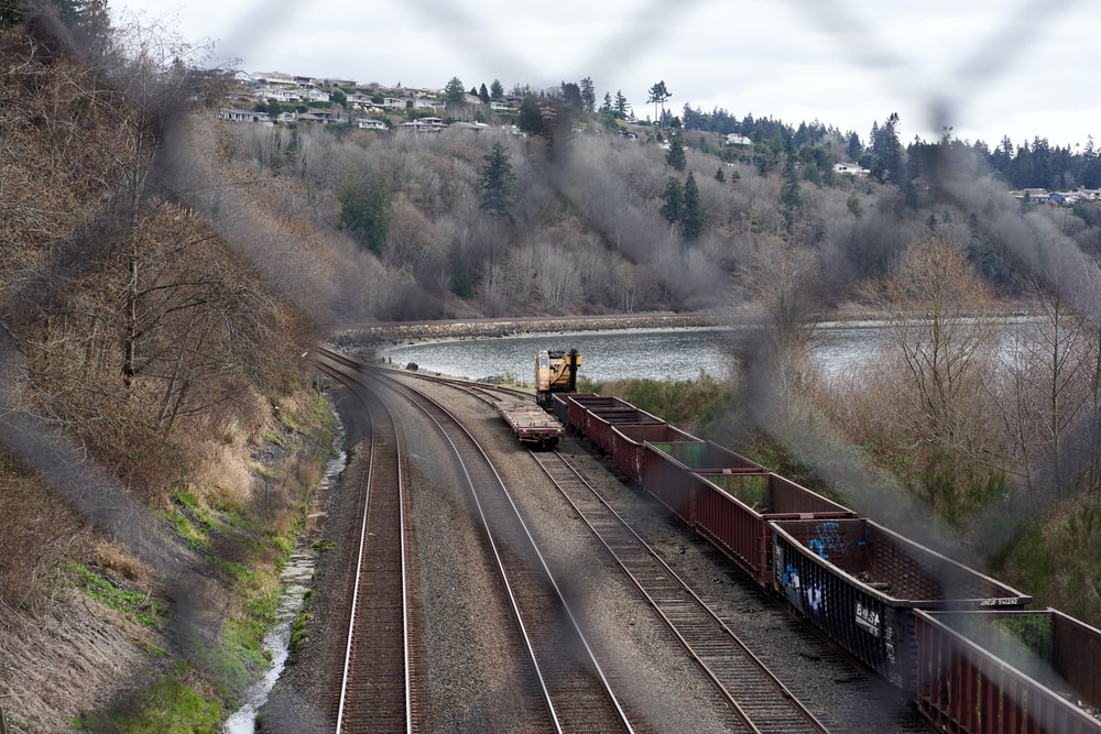 brown train on rail road during daytime