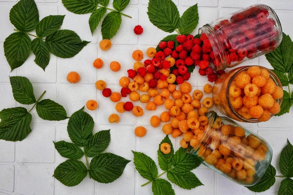 orange fruits on white table
