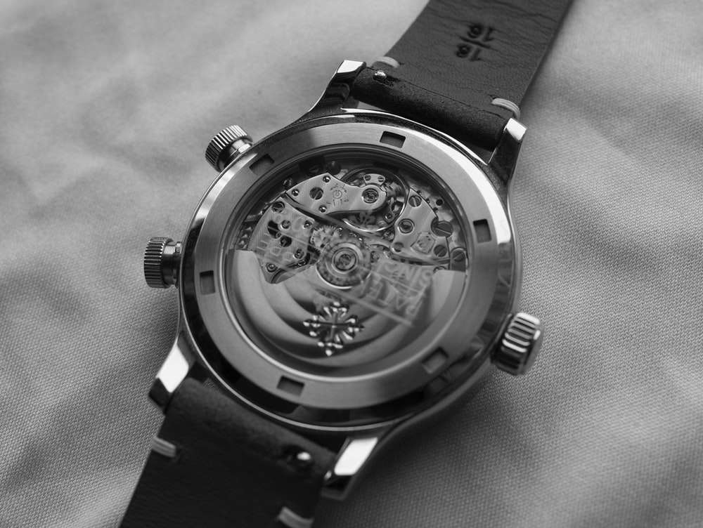 grayscale photo of round chronograph watch
