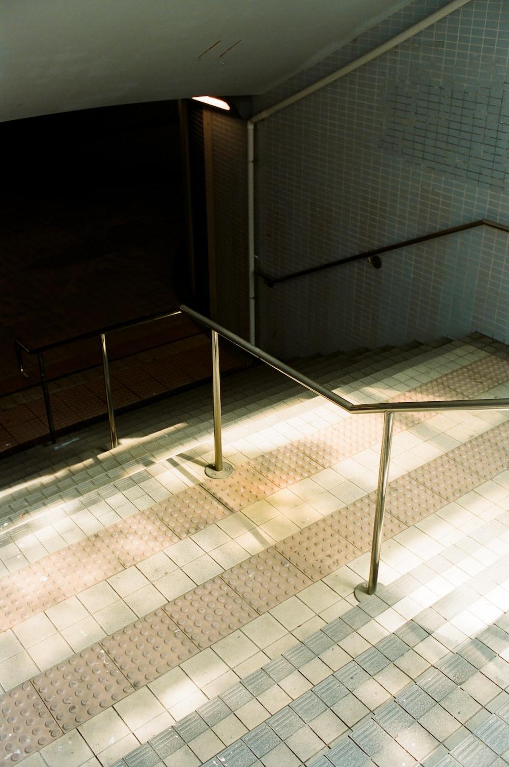 stainless steel railings on white ceramic tiles