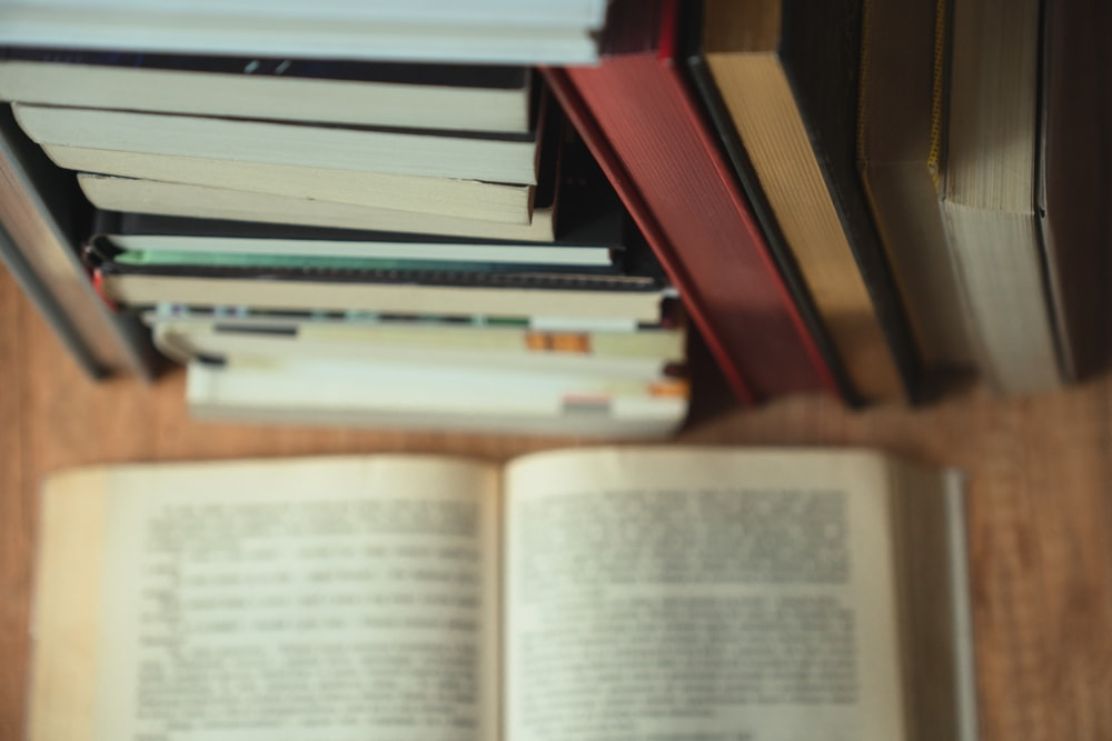 white book on brown wooden shelf