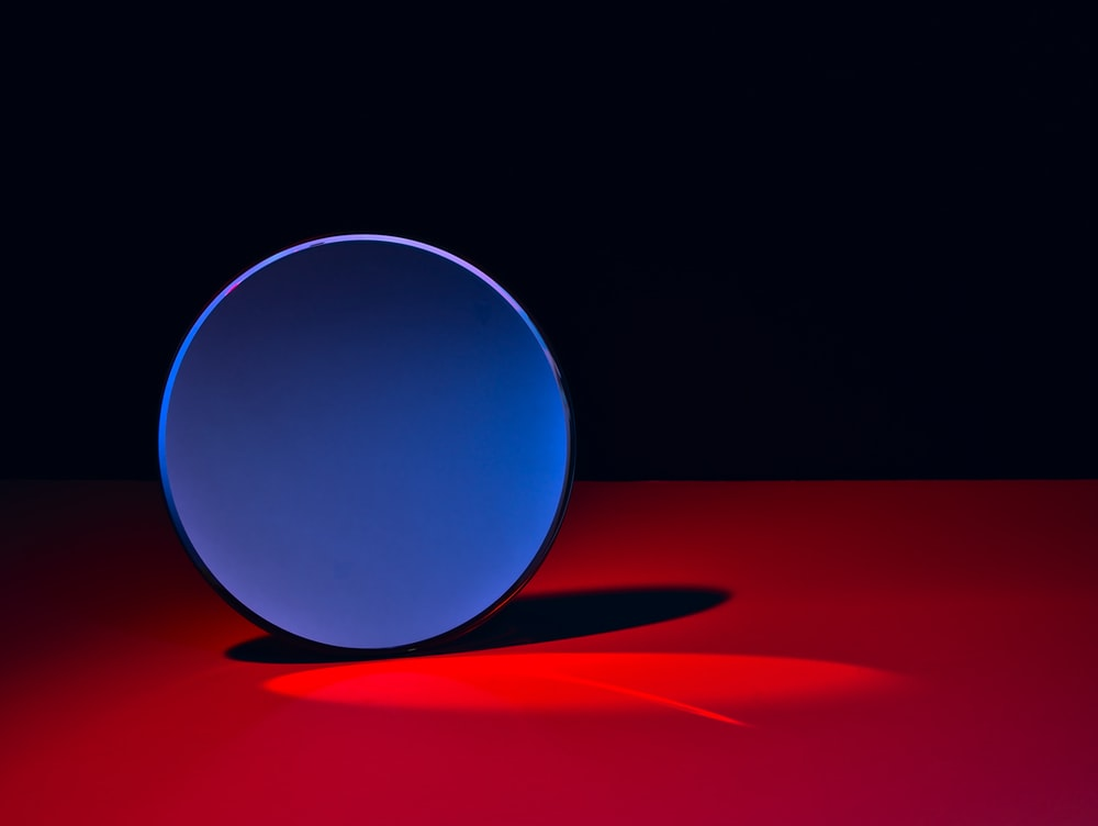 blue round ball on red textile