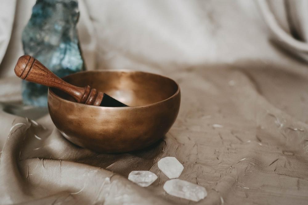 brown wooden bowl on white textile
