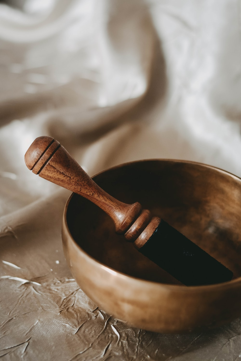 brown wooden spoon on brown wooden bowl