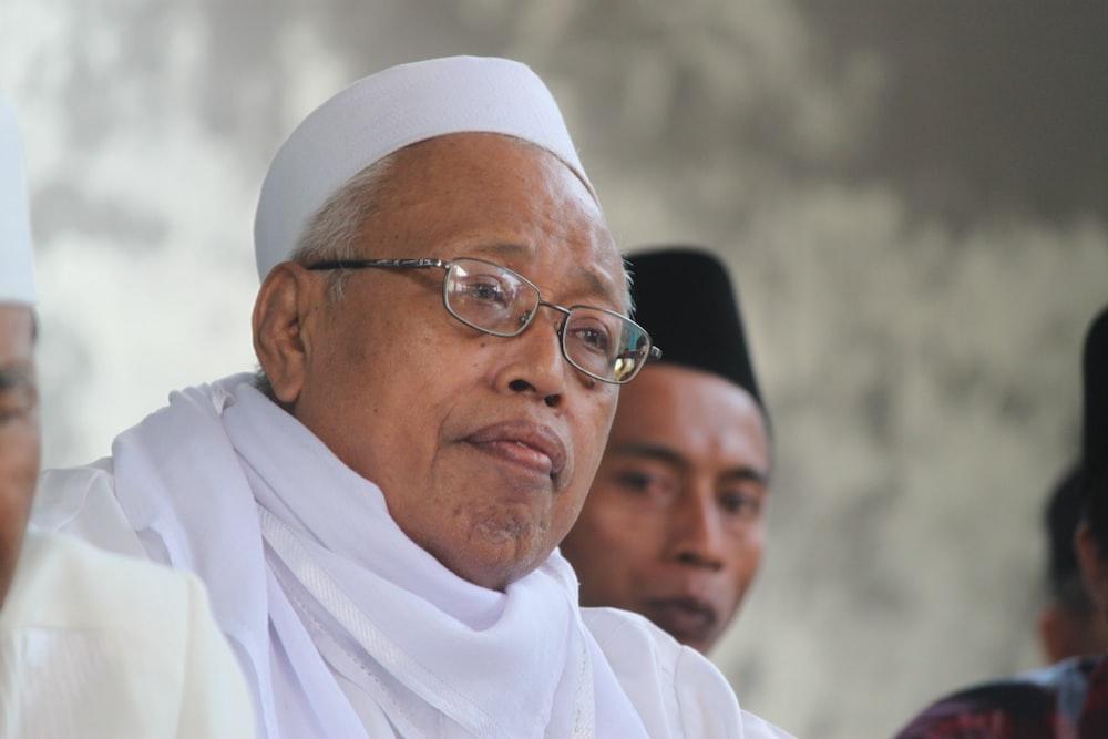 man in white thobe wearing eyeglasses