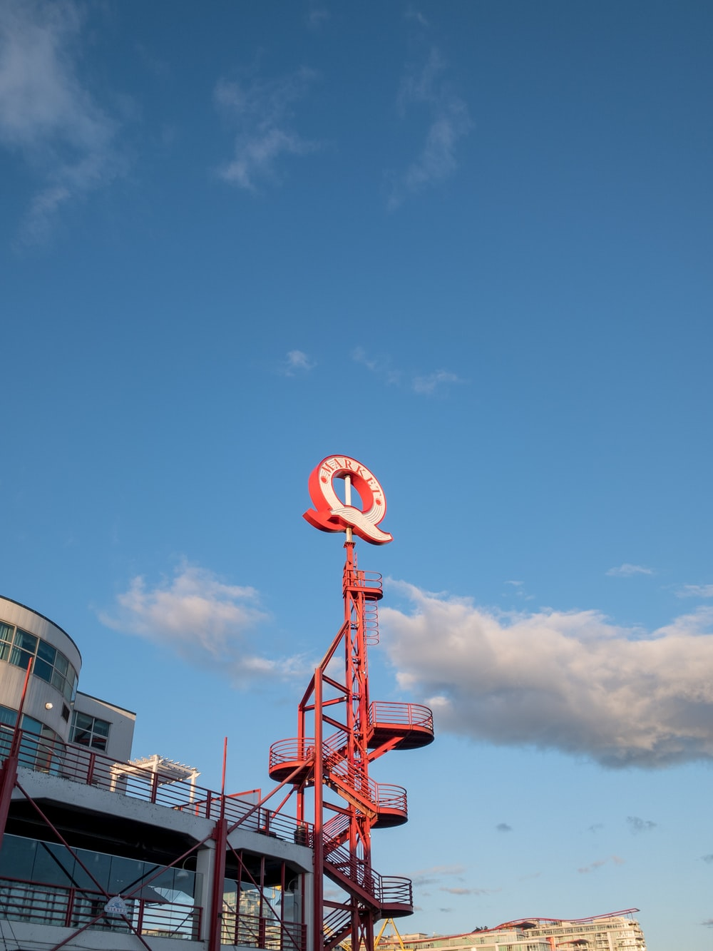 red and white steel tower under blue sky during daytime