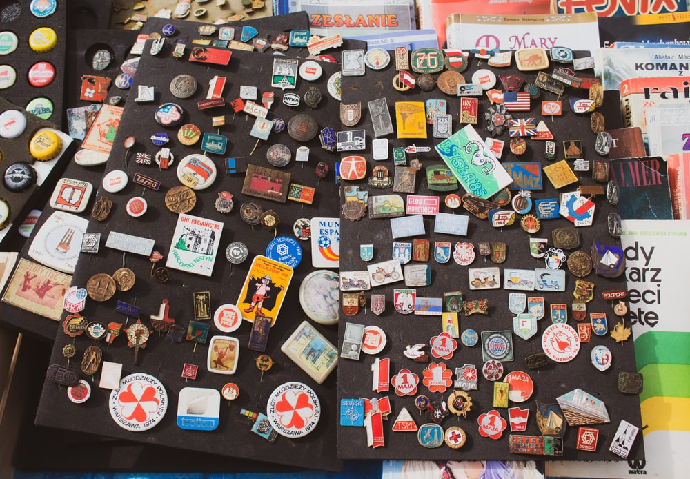 assorted sticker on red wall