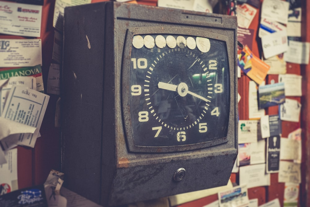 black and brown analog desk clock