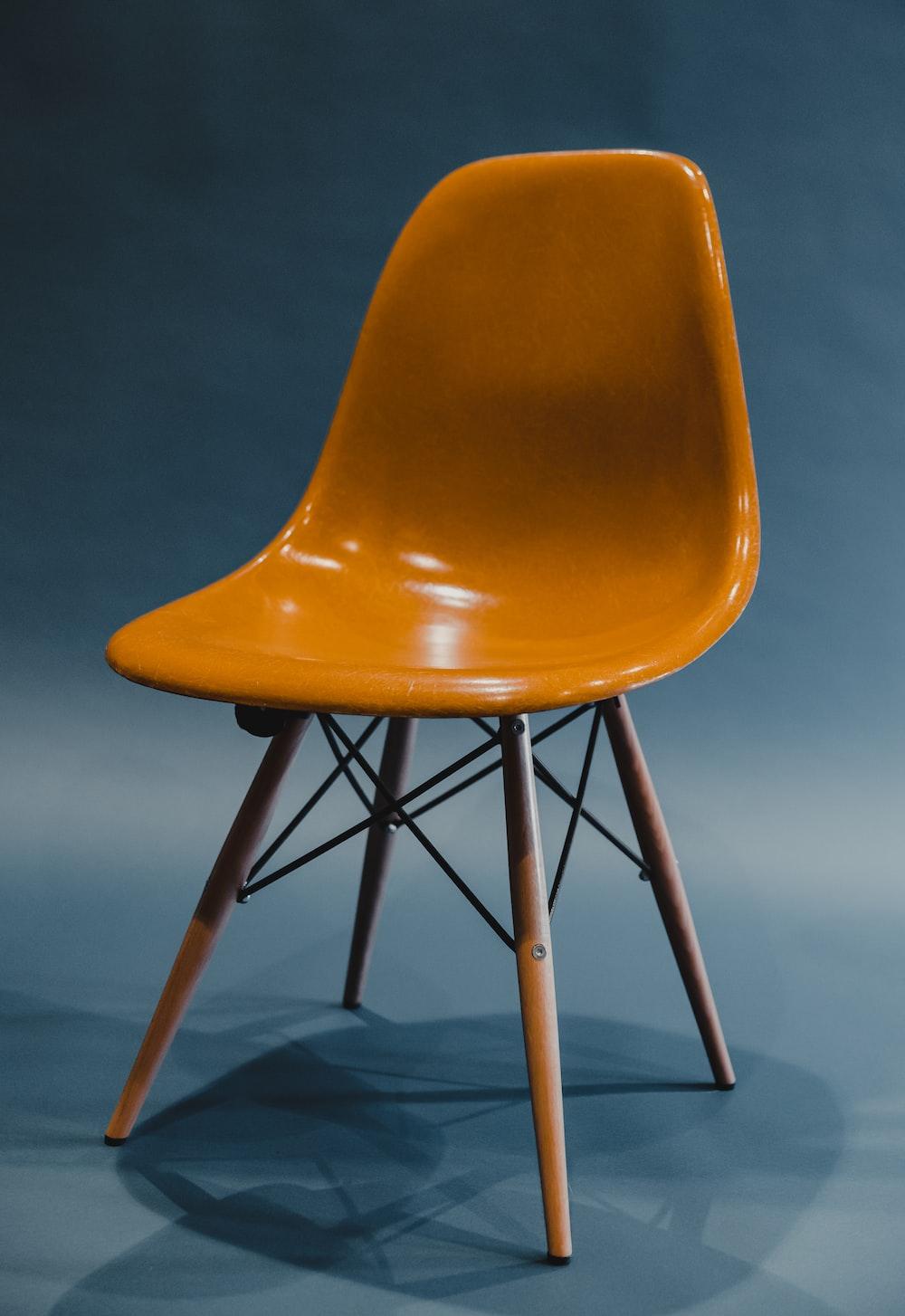 orange and black chair on brown wooden floor