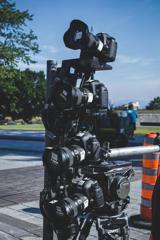 black dslr camera on black tripod