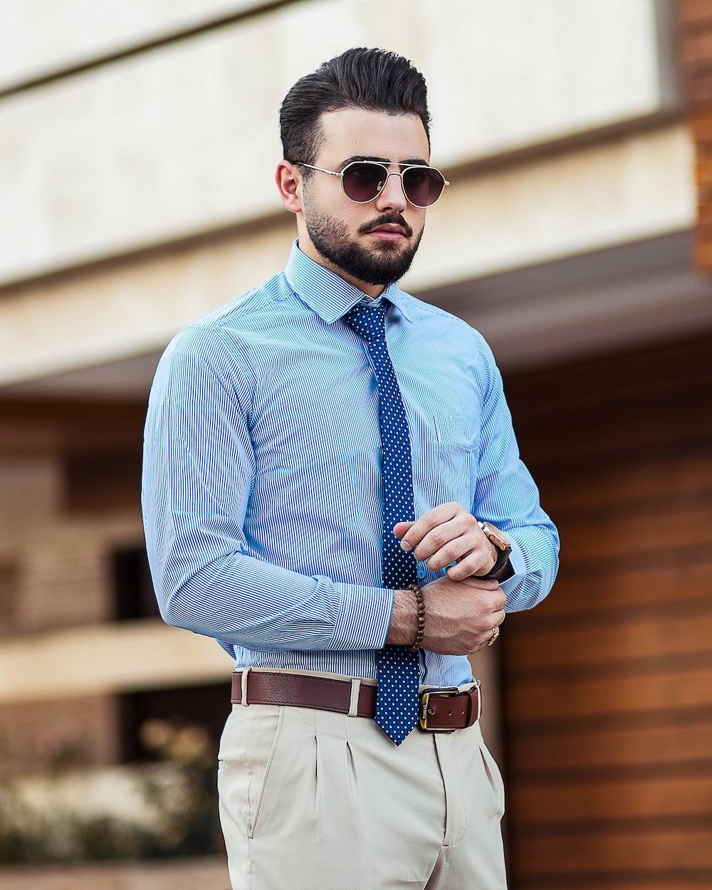 man in blue dress shirt wearing black sunglasses