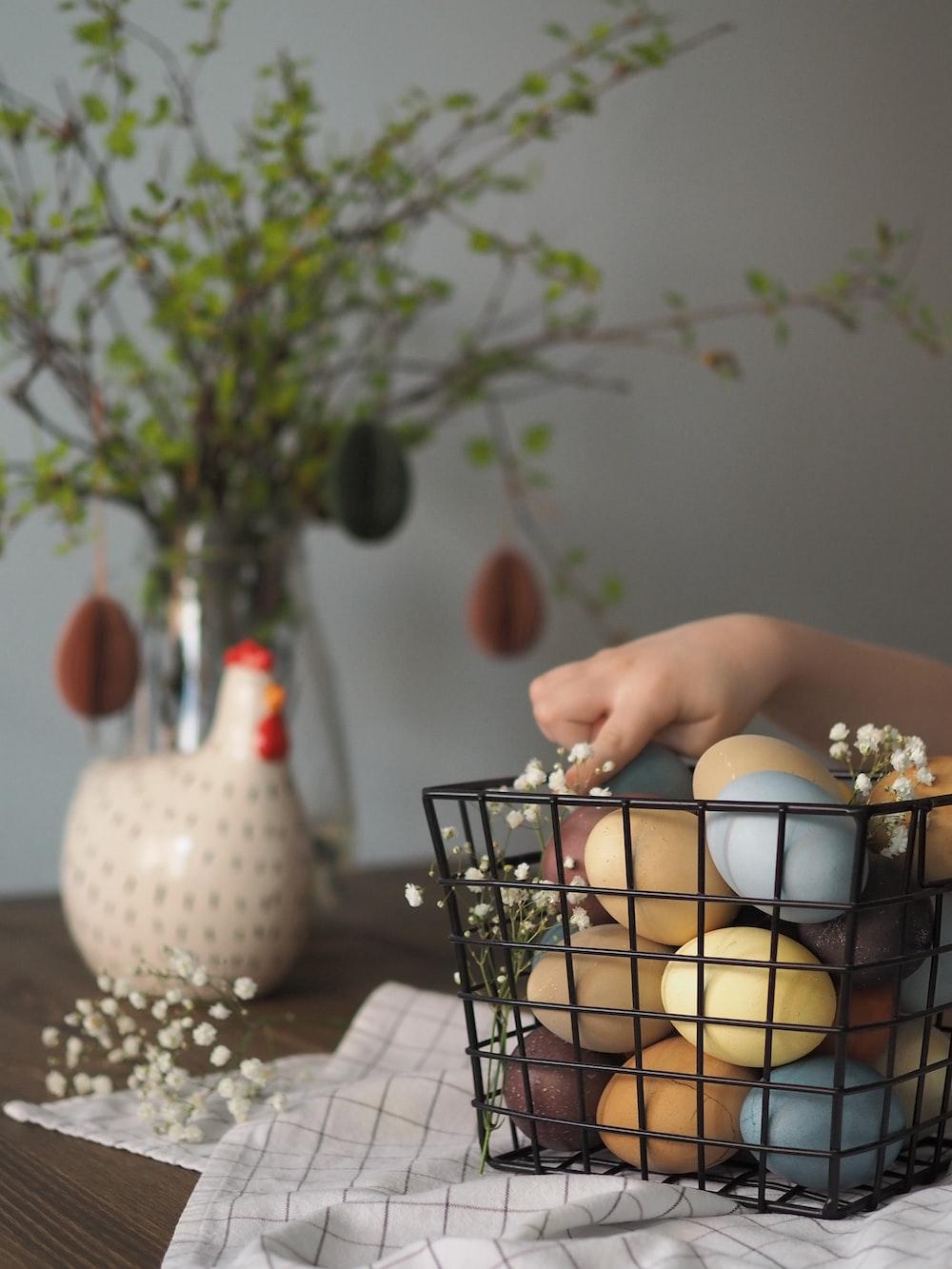 white egg in black metal basket on white table cloth