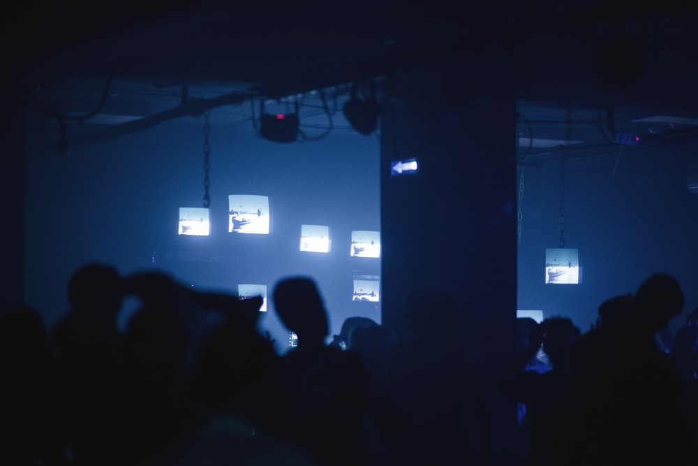 people in a room with a blue screen