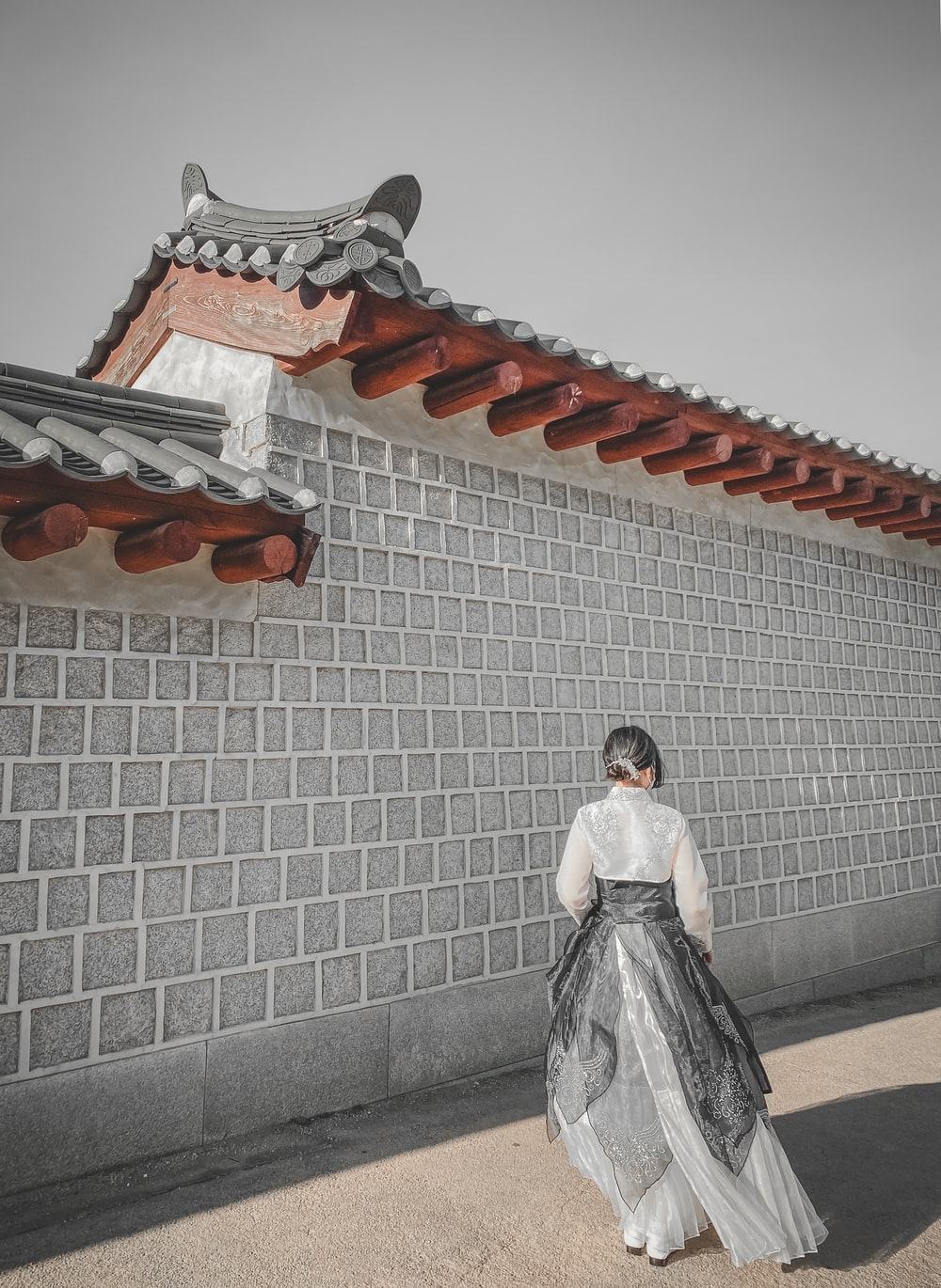 woman in white dress standing on stairs