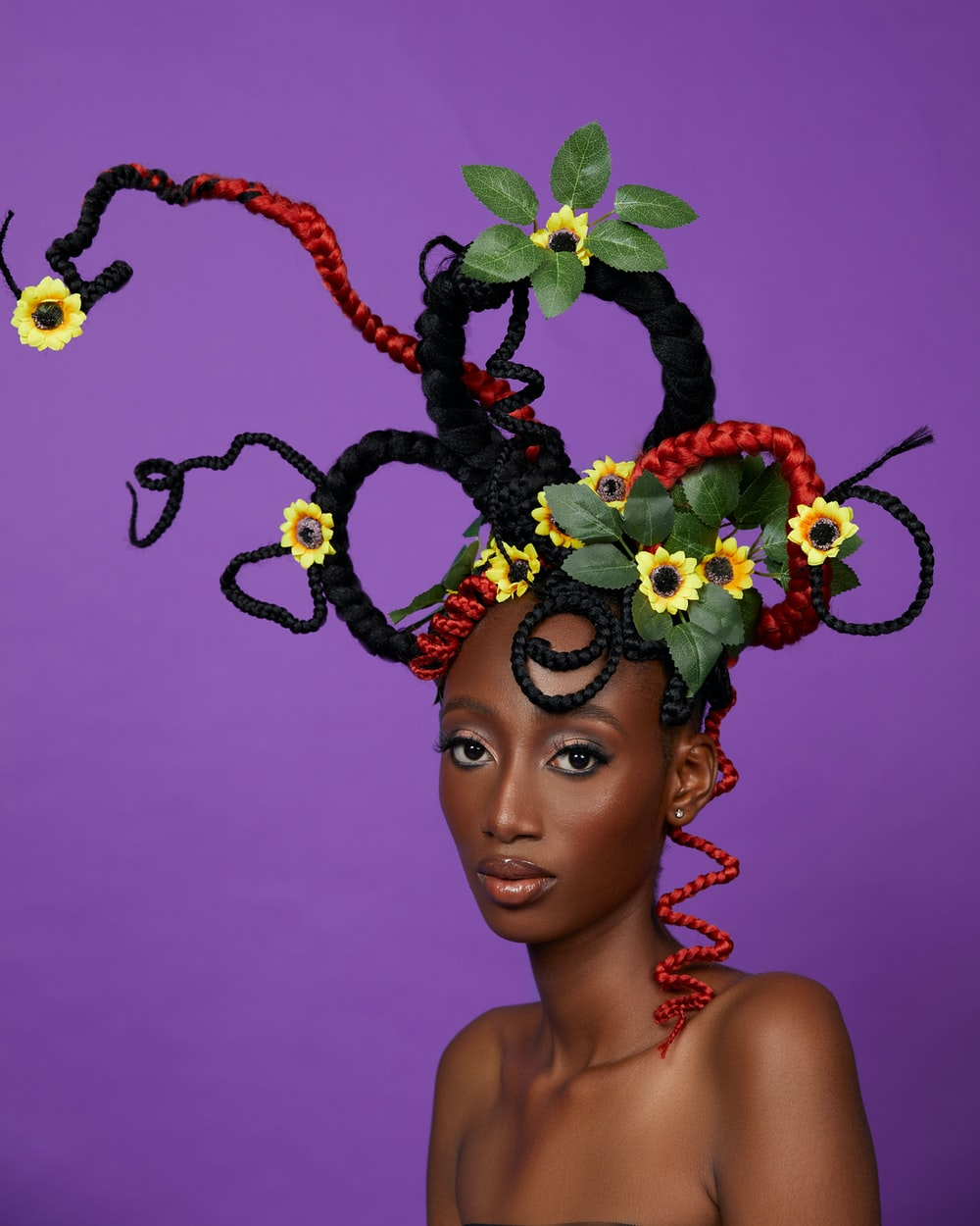 woman with yellow and green floral headdress