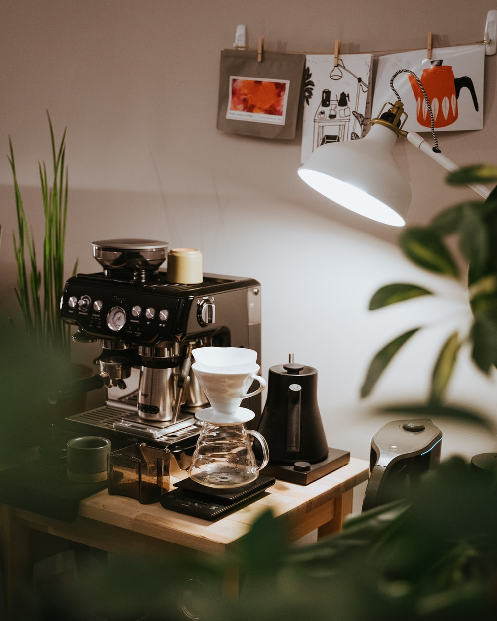 black and silver coffee maker on brown wooden table