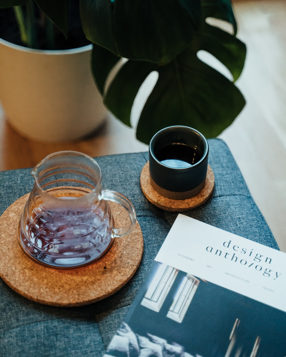 clear glass mug on brown wooden coaster