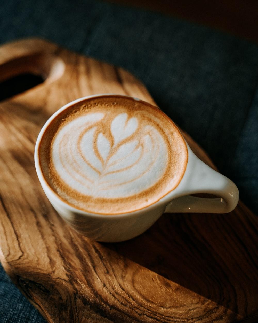 white ceramic mug with brown and white liquid