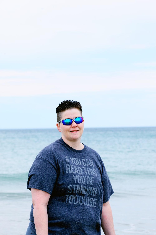 man in gray crew neck shirt wearing aviator sunglasses