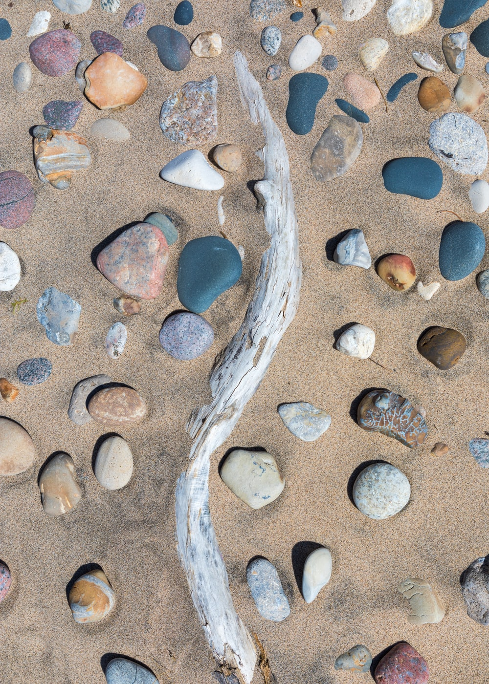 blue and brown stone fragments on beach