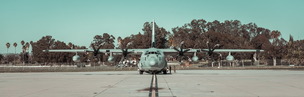gray fighter plane on gray concrete ground during daytime