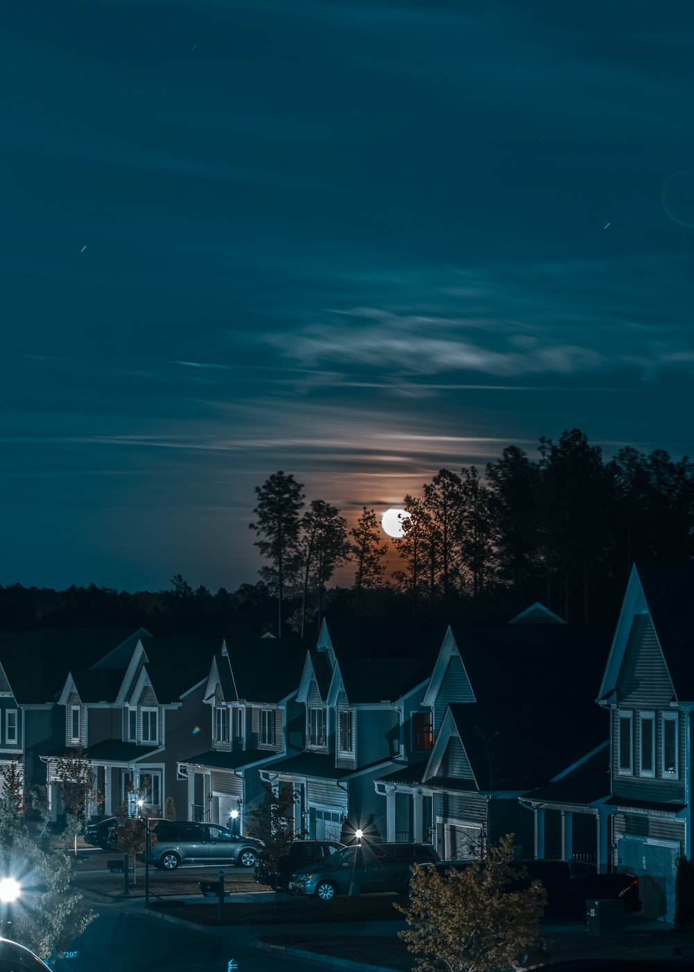 green and white houses during night time