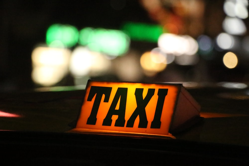 orange and black taxi sign
