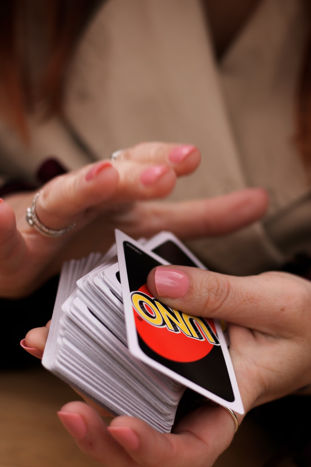 person holding white red and black card
