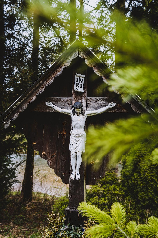 brown wooden jesus christ figurine