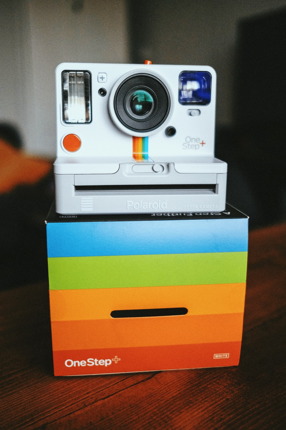 white and blue camera on yellow and blue striped box