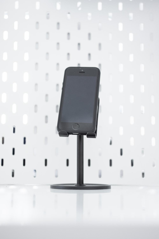 black iphone 5 on black stand
