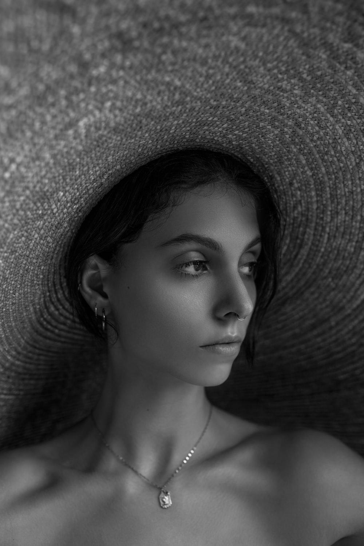 woman wearing brown sun hat