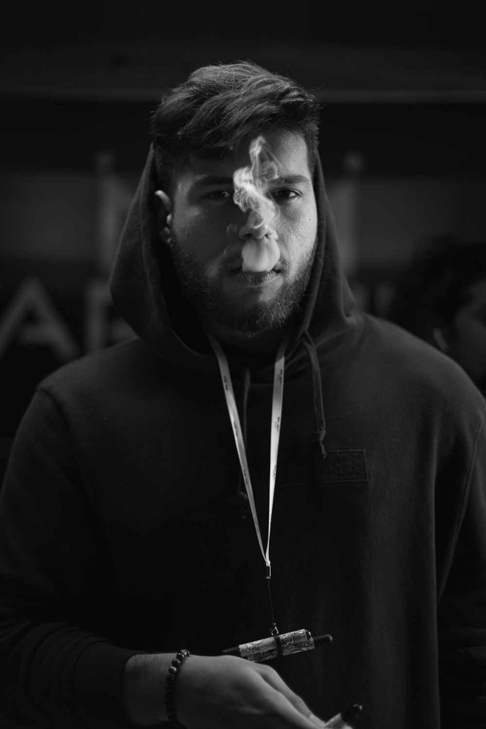 man in black hoodie in grayscale photography