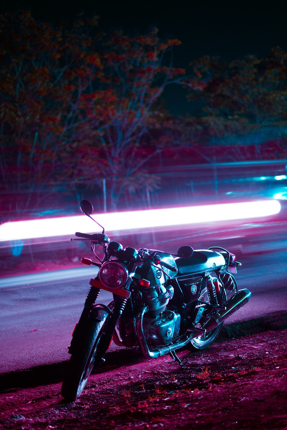 black and silver cruiser motorcycle on road during night time