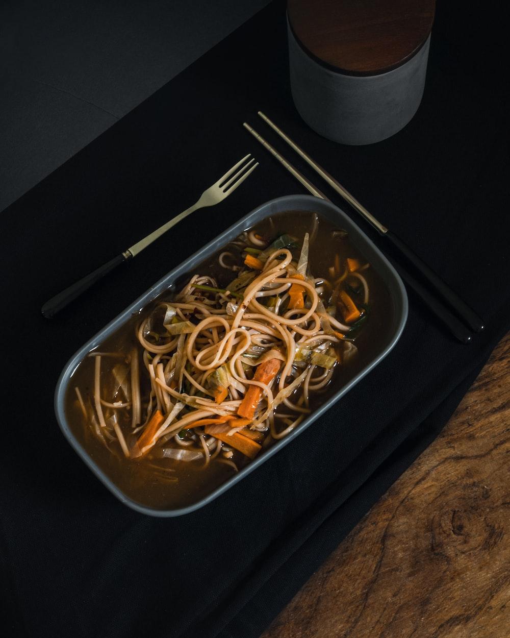 white pasta on black tray