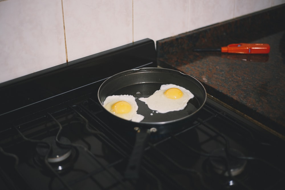 white ceramic plate on black stove