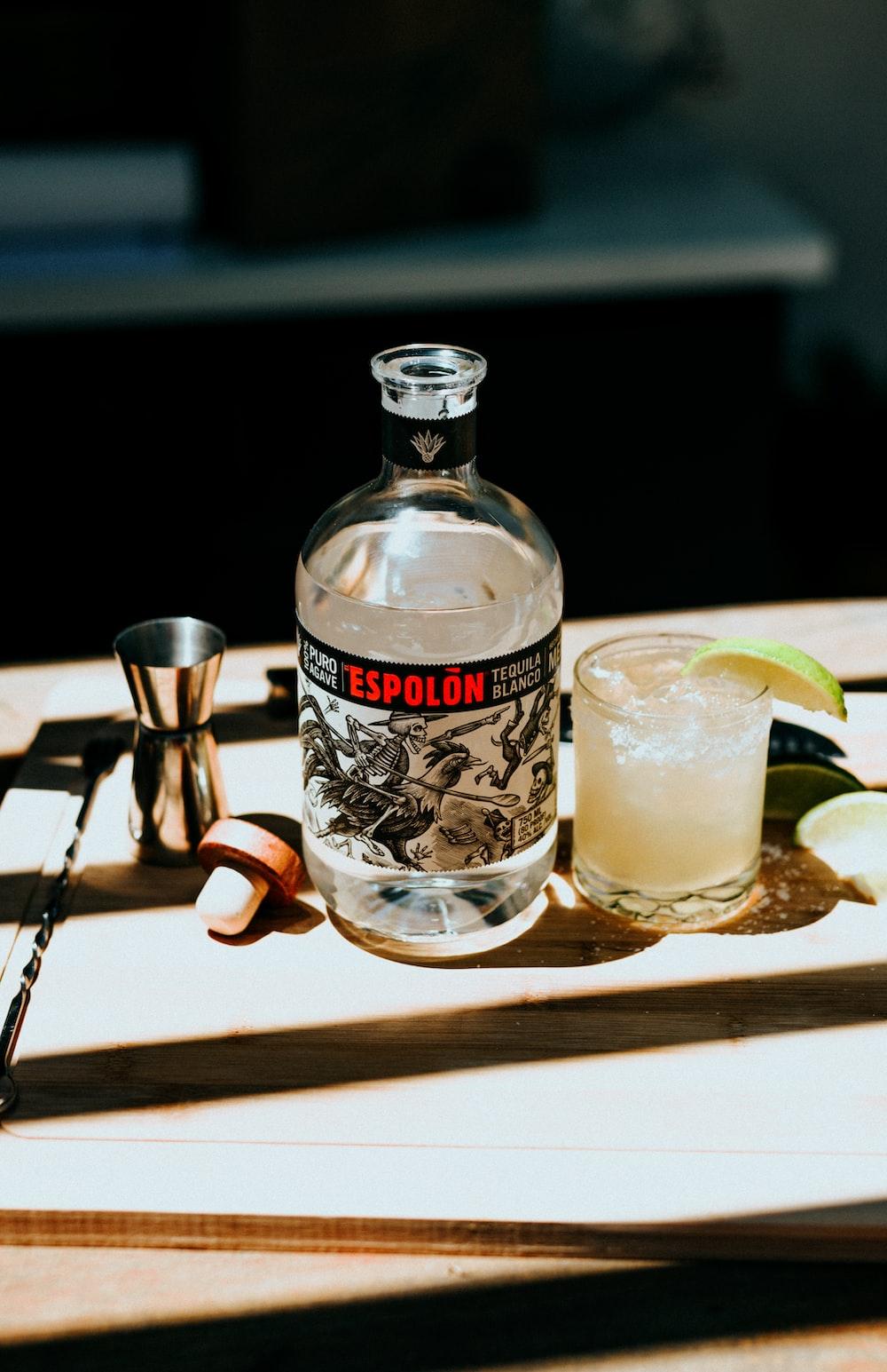 Espolòn Tequila bottle next to cocktail