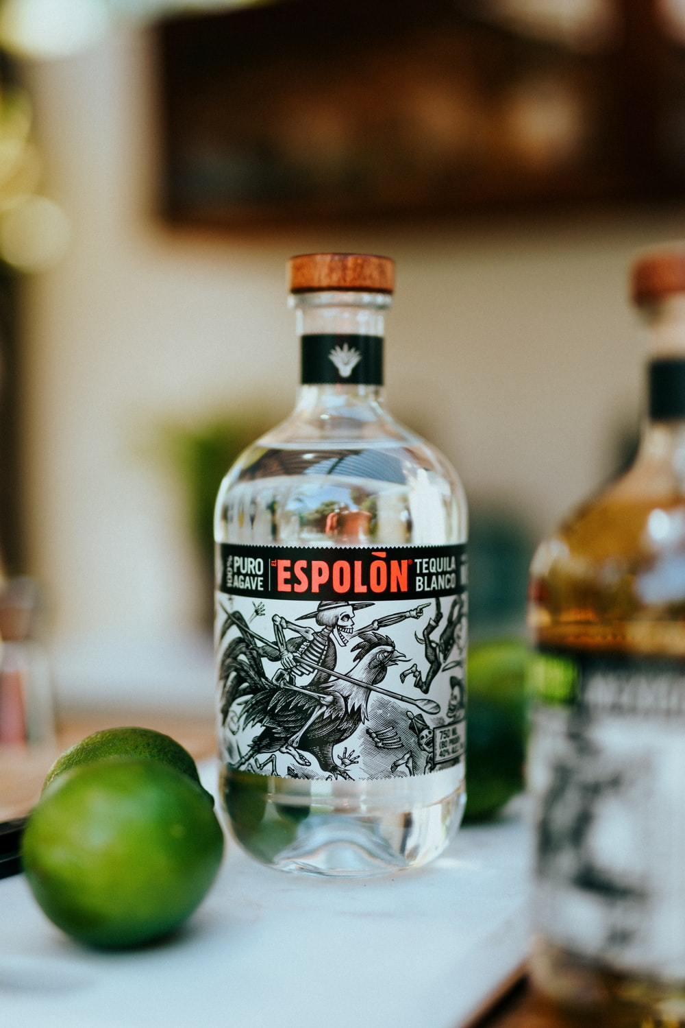 Espolòn Tequila bottle with limes