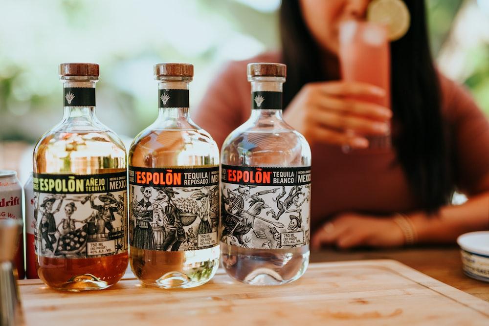 three Espolòn Tequila bottles on table