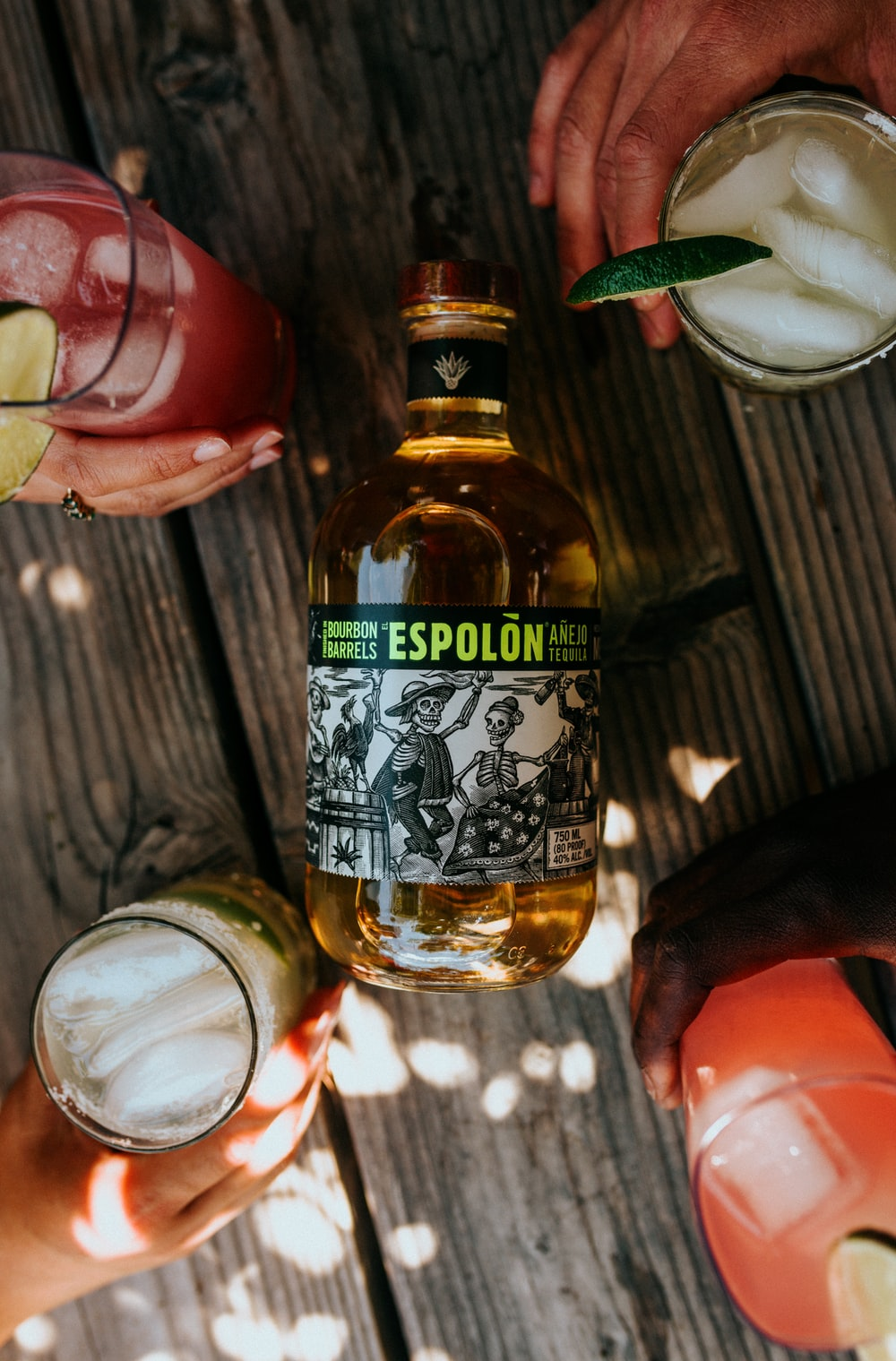 Espolòn Tequila bottle on wooden table